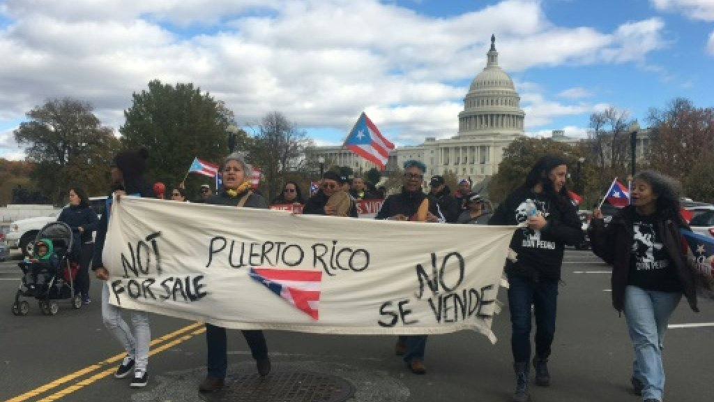 Protesters march in solidarity with hurricane-hit Puerto Rico