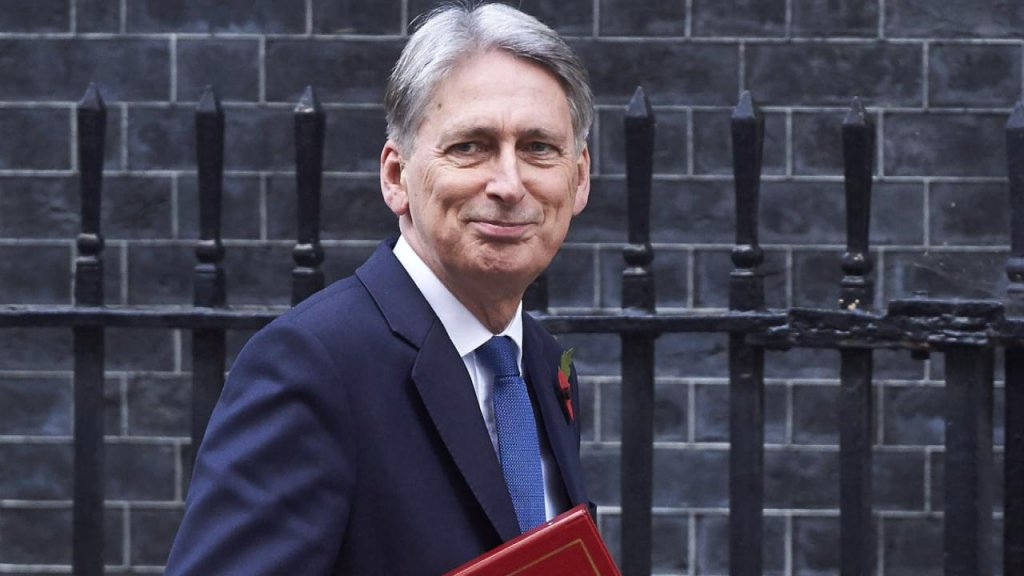 BUSINESS DAILY - Hammond teases UK budget with homebuilding, driverless cars