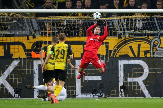 Spurs secure top spot with comeback win at Dortmund