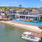 Records tumble across surging coastal property market