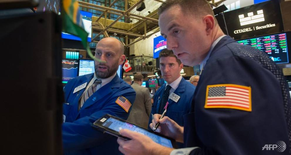 Nasdaq edges to record as Fed minutes signal higher rates