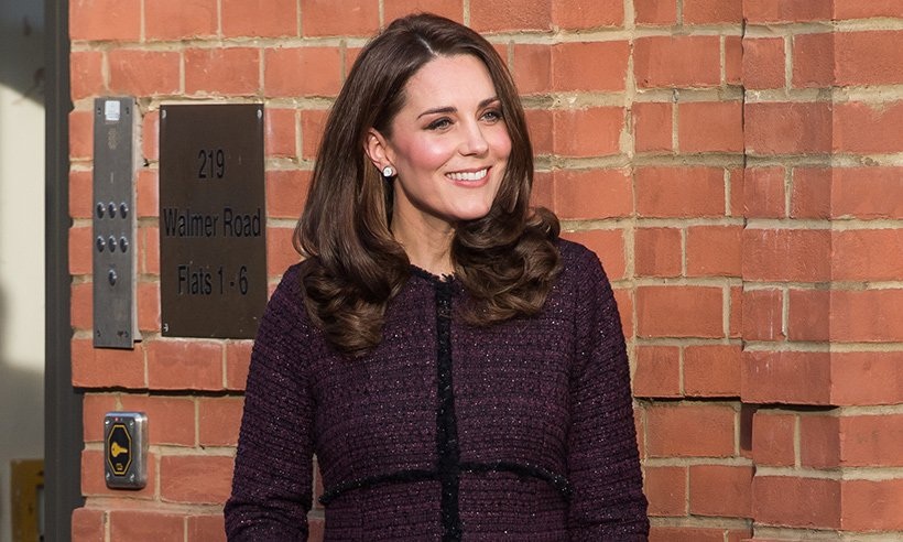 Mrs Claus! Kate hands out presents at children's Christmas party: