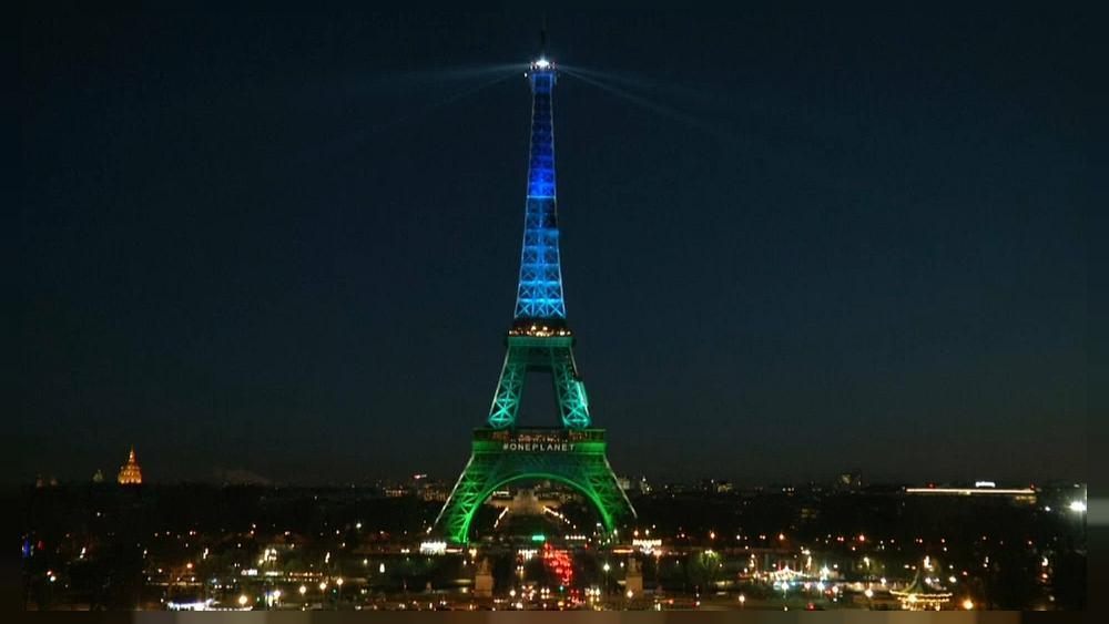 Eiffel Tower lit up with vegetable oil