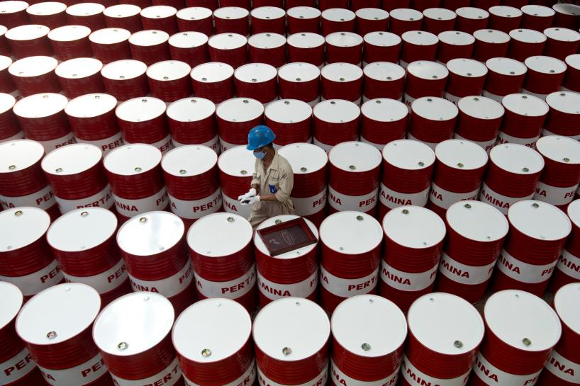 Oil dips on rising U.S. fuel stocks, but OPEC's supply cuts support market