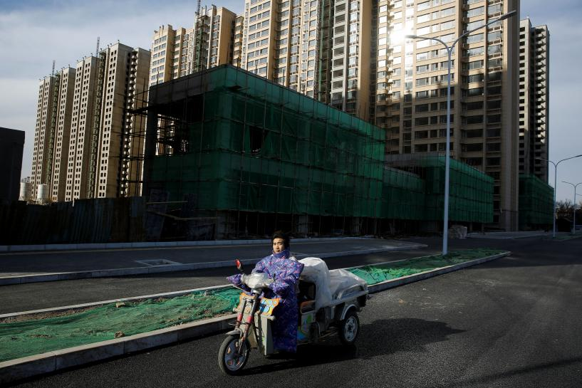 China November property investment growth slows, sales pick up