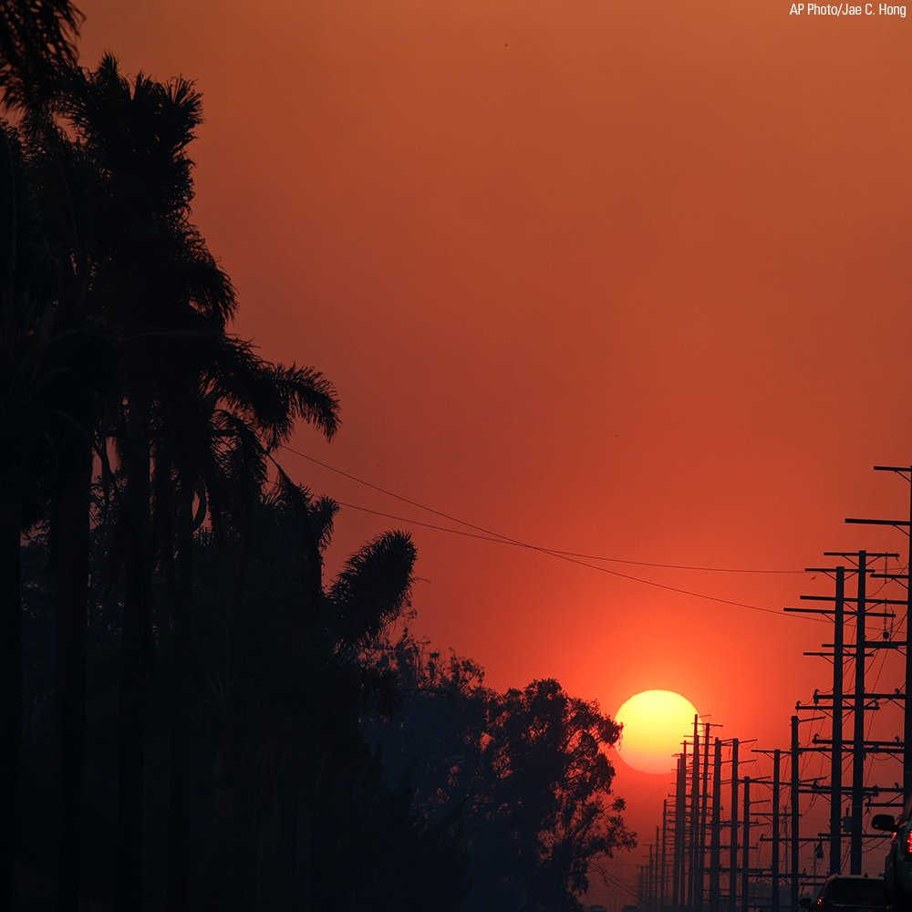The sun is seen through thick smoke generated by a wildfire in SantaPaula, California.
