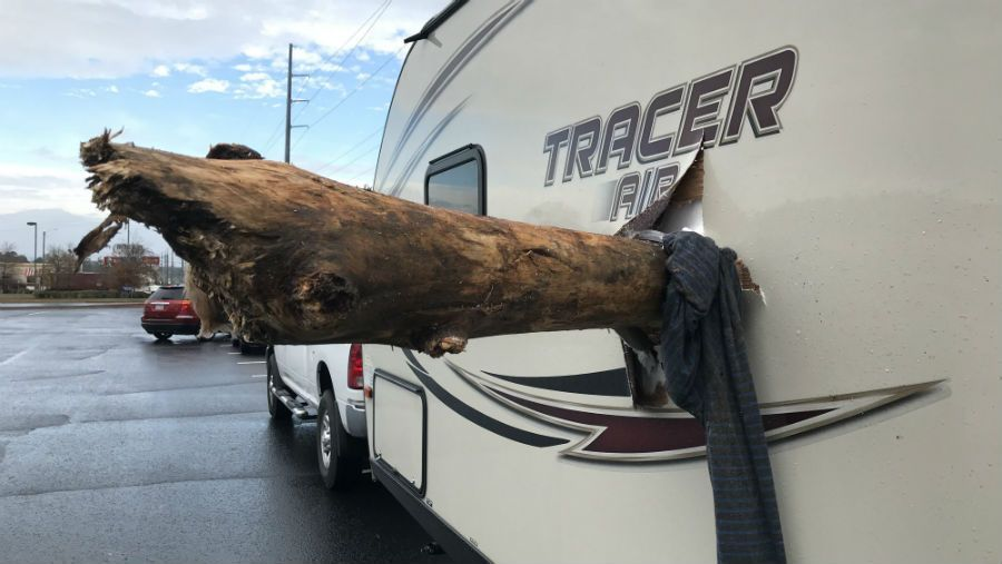 Travel trailer impaled by log after falling from 18-wheeler -   WBTV Charlotte