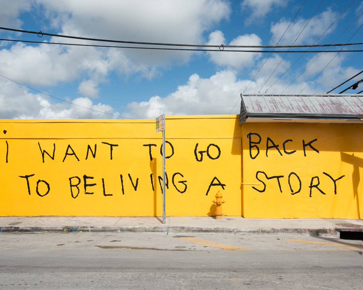 """i want to go back to beliving a story,"""" features on the art wall in ..."""