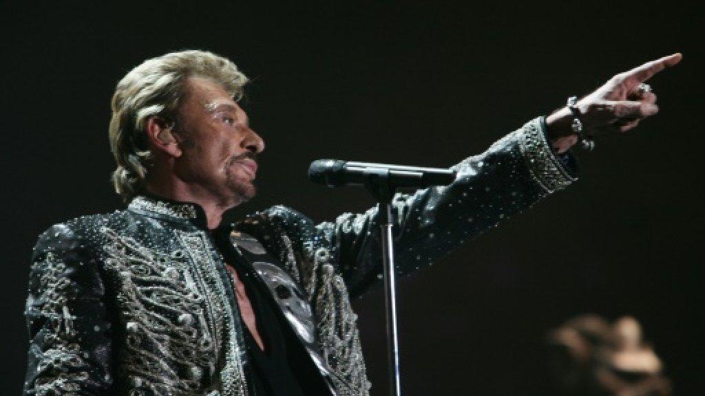 France awaits rocker Hallyday's final show -- his funeral