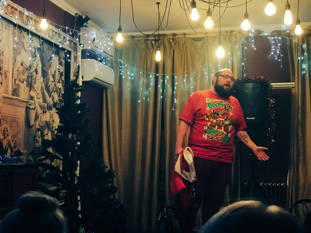Chief Elf Liam of @EncompassOnline rocking the @TheNewDayWWE Booty Ho-Ho-Ho's tshirt at #BareEssentialsLDN https://t.co/X9WeEdNa3G