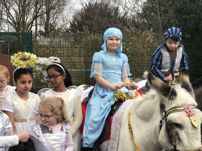 Riding on a donkey, getting ready to go to St Philips Church https://t.co/peFxjRakWS
