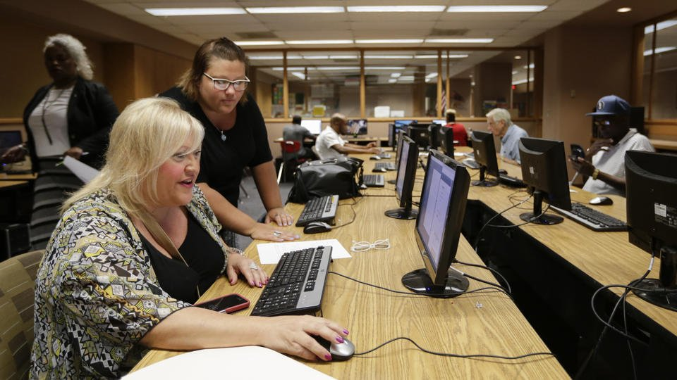 US job openings slip in October, but hiring increased