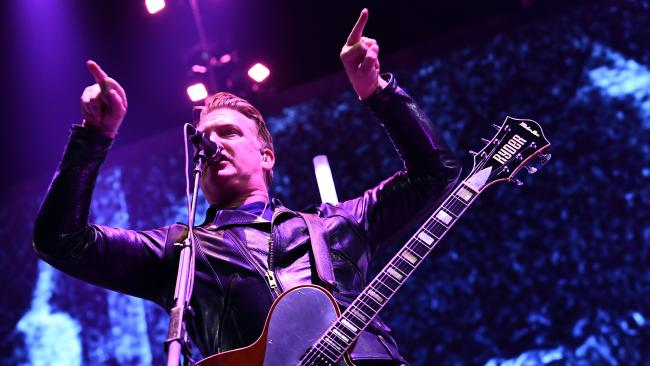 'Truly sorry': Queens of the Stone Age singer apologises for kicking photographer