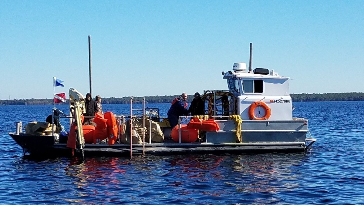 Crews work to recover plane wreckage from Lake Harney