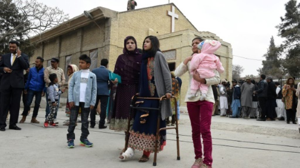 Grieving Pakistani Christians mark Christmas days after IS attack