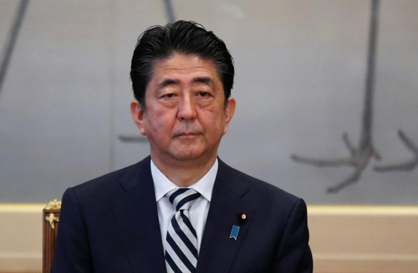 Japan PM Abe urges firms to raise wages by 3 percent or more
