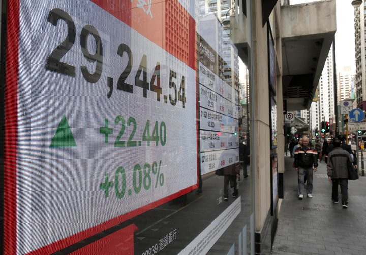 @BroadcastImagem: Bolsas asiáticas fecham majoritariamente em baixa após alta de juros nos EUA. Kin Cheung/AP