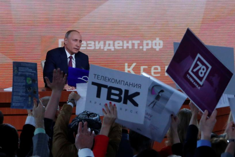 Russia's Putin, on track for easy re-election, laments dearth of rivals