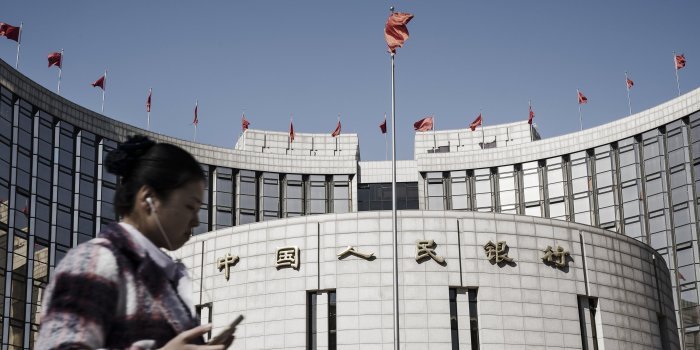 China's Central Bank Raises Market Rates Hours After Fed Move
