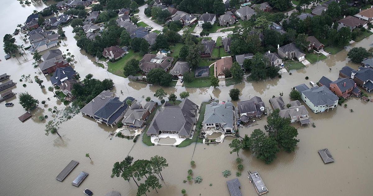 How did global warming affect Hurricane Harvey?