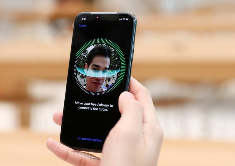 Faulty iPhone X facial recognition software allows woman's colleague to unlock phone