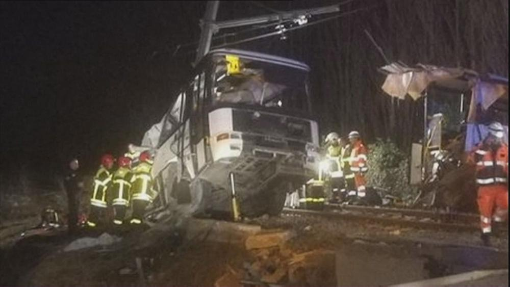 French investigators wait to speak to bus and train drivers in wake of crash that killed four children