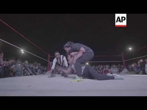 Female wrestlers give stigma a body slam