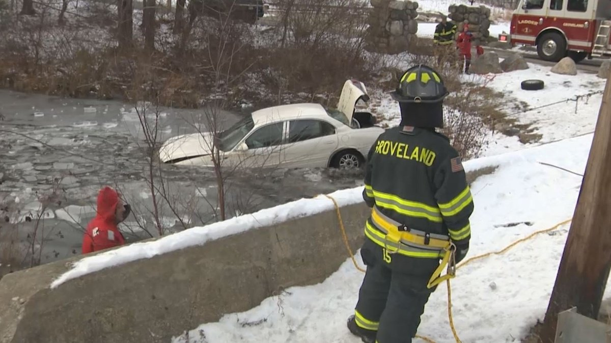 Woman rescued after car plunges into icy pond