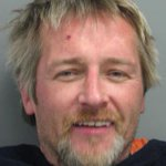 Homeless man charged in a warrant with first-degree murder in death of Bluffs man