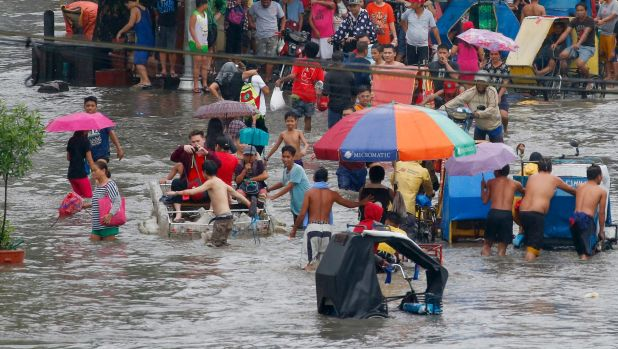Tropical storm Kai-tak floods central Philippines