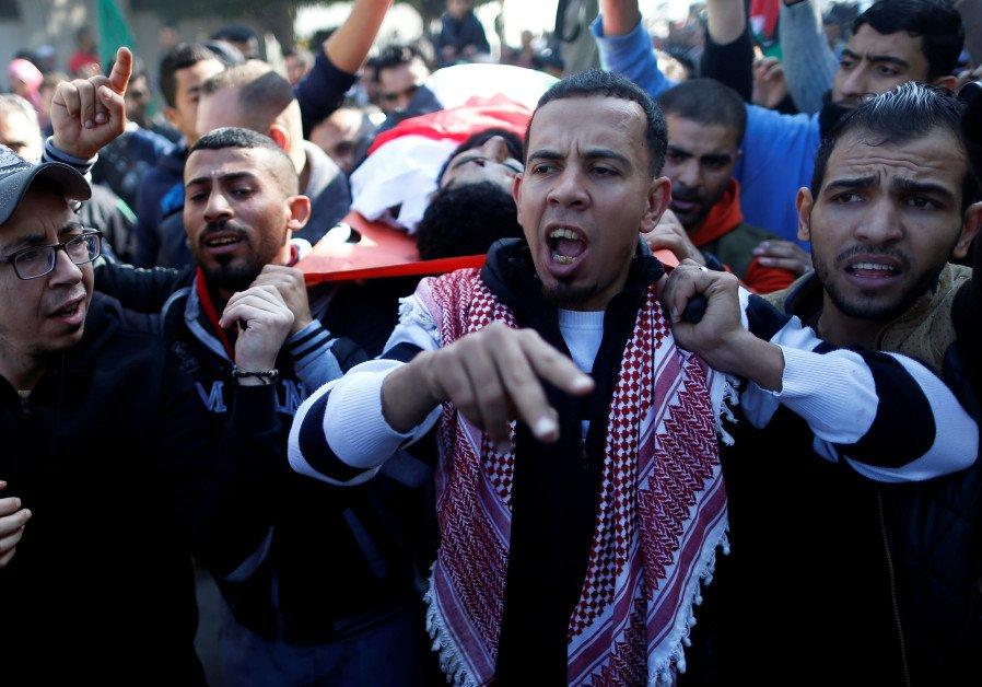 Thousands attend Gaza funeral of wheelchair-bound Palestinian activist