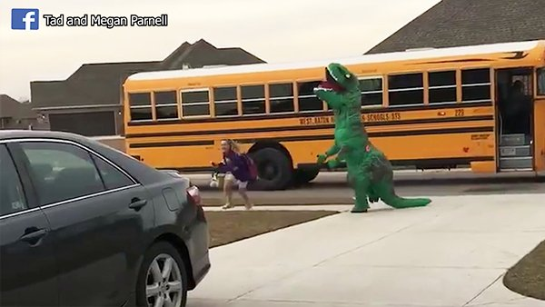 VIDEO: Hilarious father wearing dinosaur suit greets daughter at - | WBTV Charlotte