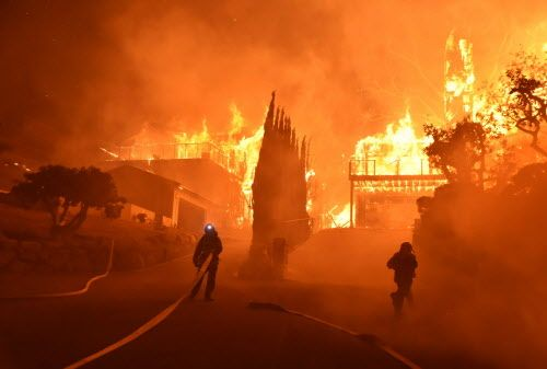 Calif. wildfires threaten coastal communities as firefighters mourn for loss of colleague