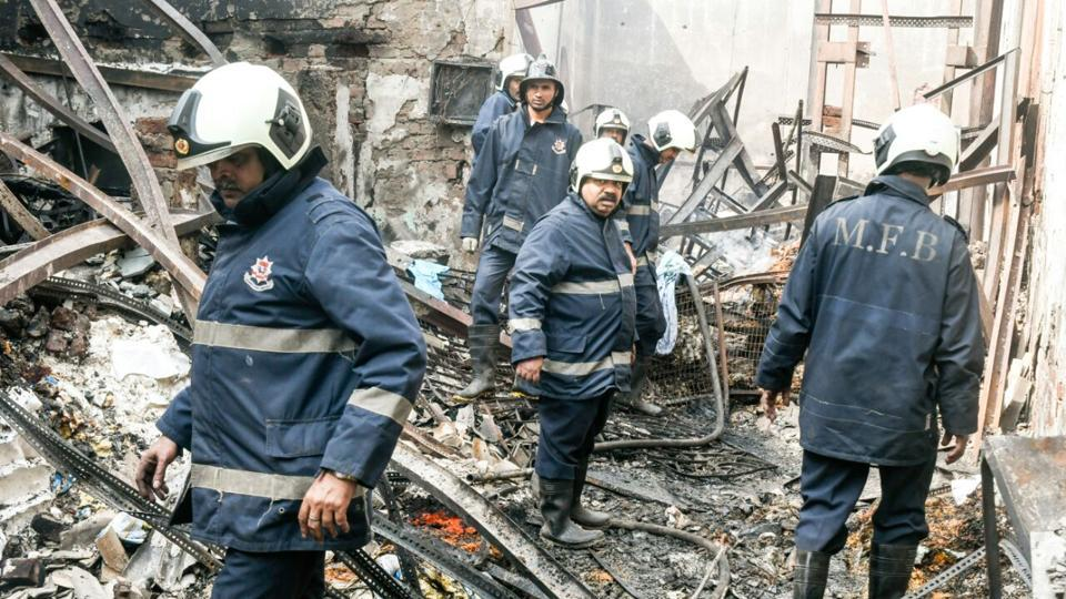 Photos: At least 12 killed after fire and collapse in Mumbai shop