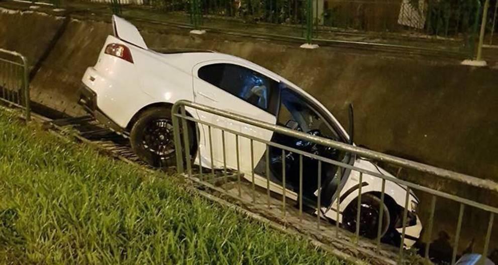 Driver flees after crashing car into drain along Sims Way