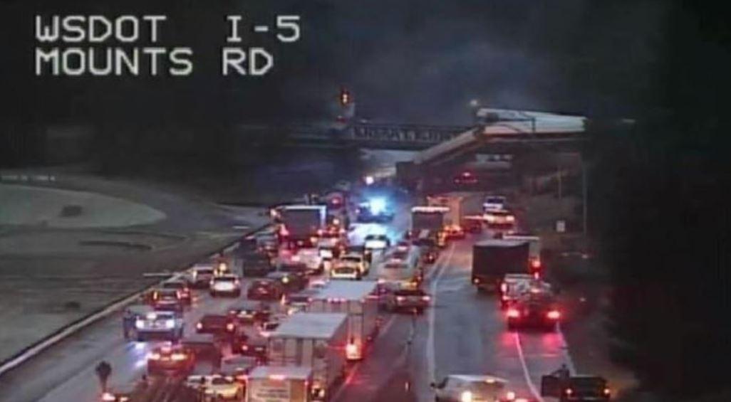 Derailed Amtrak train car falls off bridge in Washington state
