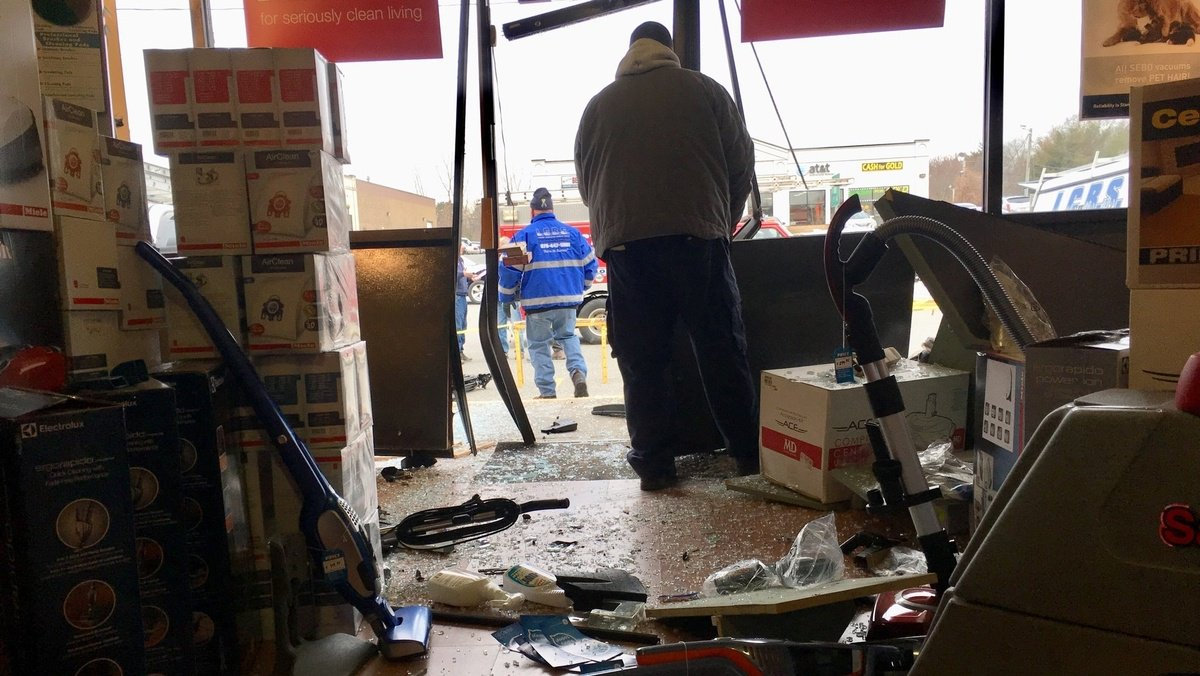 Cleanup required: Car slams into vacuum showroom