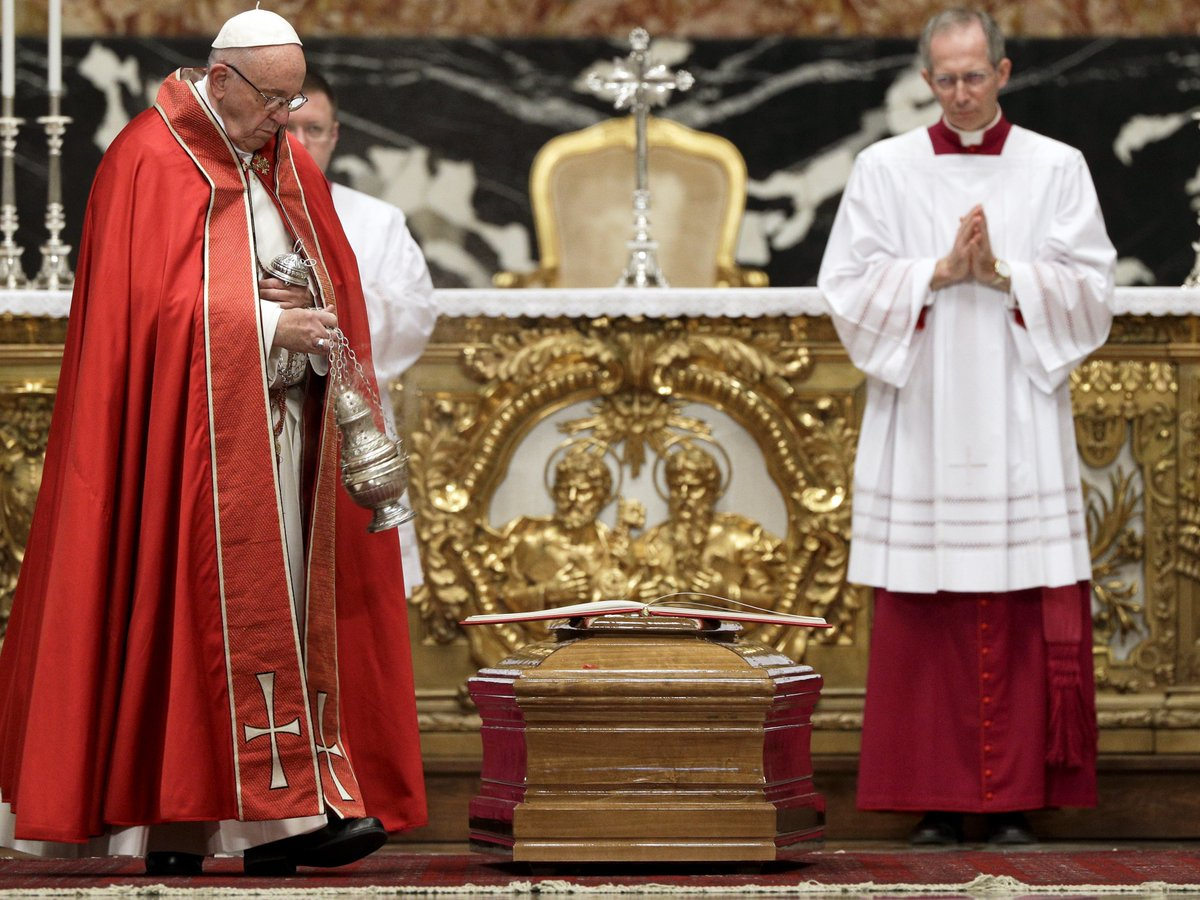 Pope Francis administers final rites at Cardinal Law funeral as abuse victims speak out