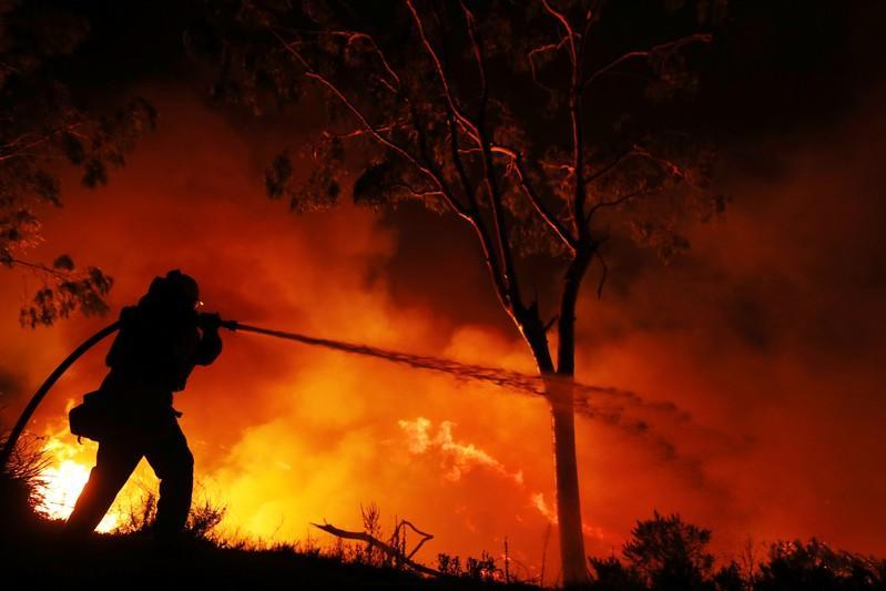 California wildfire crews gain edge as winds weaker than feared