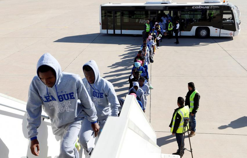 Libya puts 142 migrants on plane back to Guinea