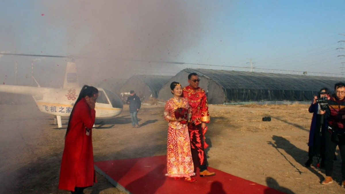 Chinese villager hires helicopter to take his bride to wedding