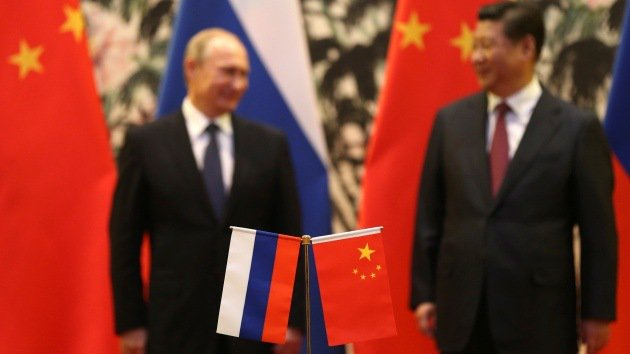 Xi to Putin: China ready to expand cooperation in 2018