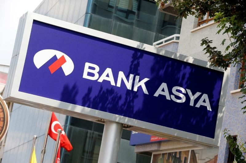 Turkey issues detention warrants for 68 Bank Asya shareholders in post-coup probe: police