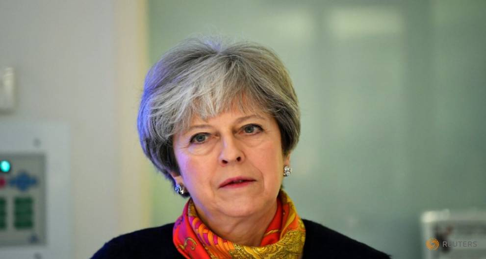 British PM May apologizes as overwhelmed hospitals cancel non-emergency operations