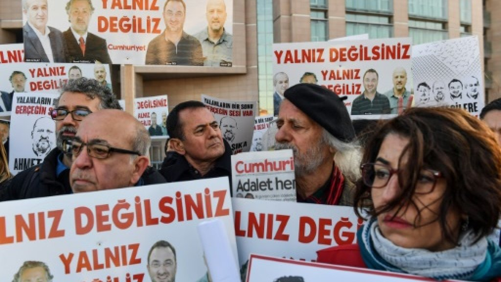 Turkey hits back over Macron comments on jailed reporters