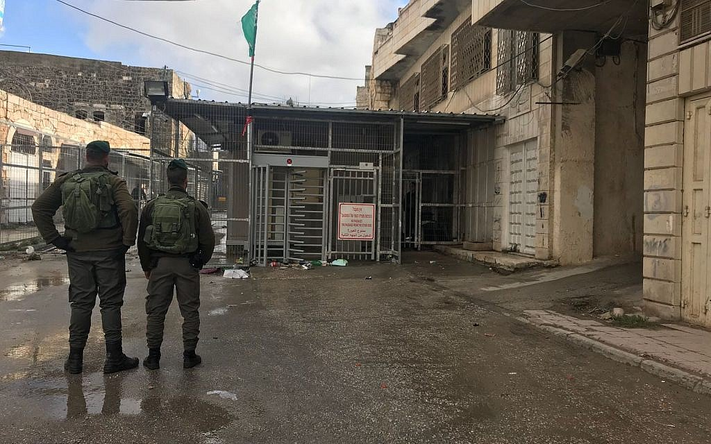 Palestinian woman caught with knives outside Hebron holy site