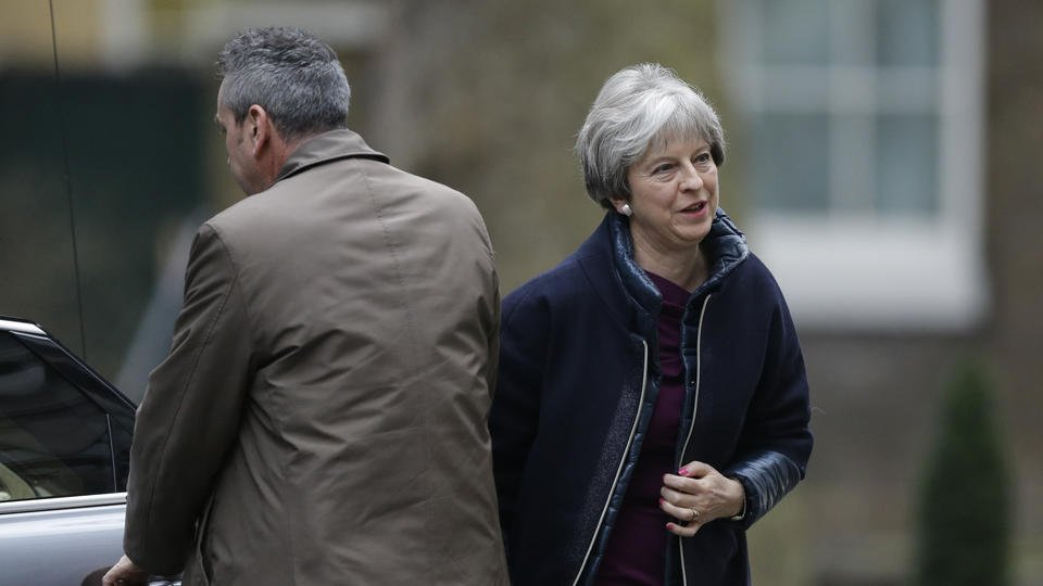 UK's Northern Ireland minister quits as May shuffles Cabinet