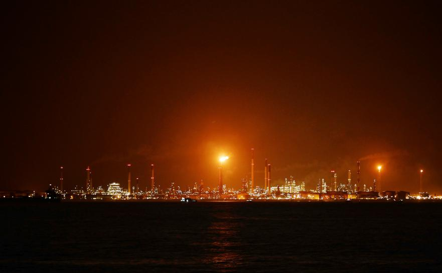 Singapore charges 11 men over Shell oil heist