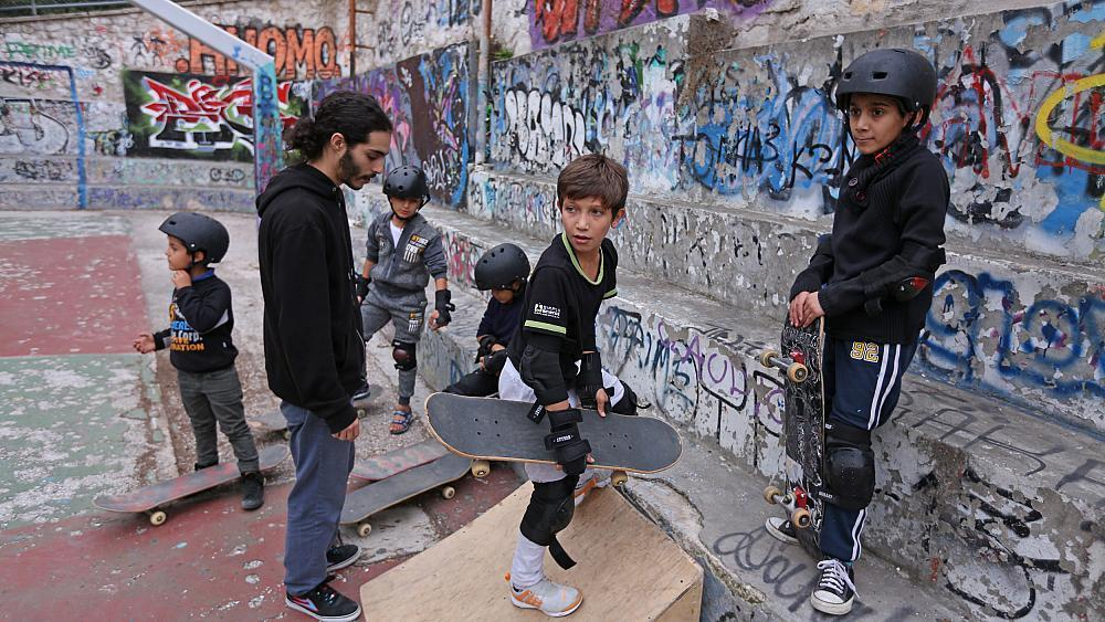 Skateboarding teaches young refugees how to fall — and get back up