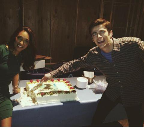 Here you can see a silly-looking Grant Gustin and Candice Patton murdering a cake. Happy Birthday